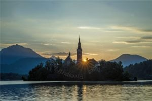 Lake Bled, Slovenia, at Sunrise, shot at f18 to achieve the sunburst.